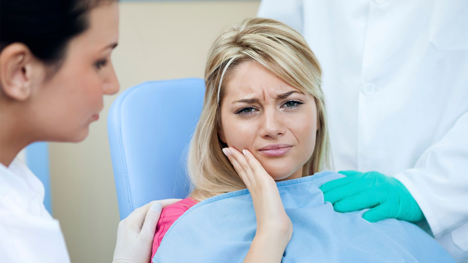 Dentist treating Patient having impacted Tooth